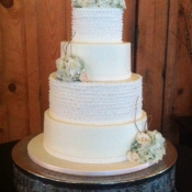 Ruffle And Flower Wedding Cake